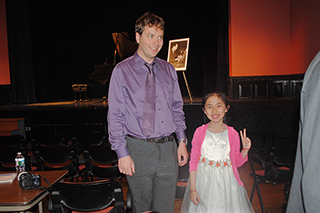 Photo Gallery of YM Piano Studio in Central New Jersey, East Windsor. JENNIFER LIU with her piano teacher YEVGENY MOROZOV, East Windsor.