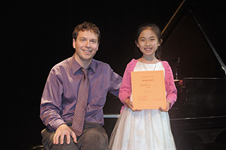 Photo Gallery of YM Piano Studio in East Windsor.  Piano Studio Gallery:  JENNIFER LIU with her teacher, pianist YEVGENY MOROZOV.